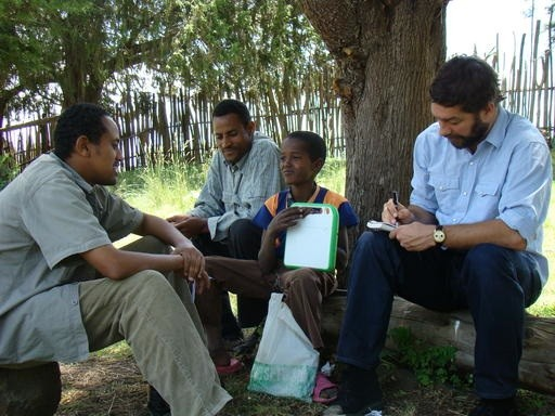 Journalist Interviewing the Head Schoolteacher