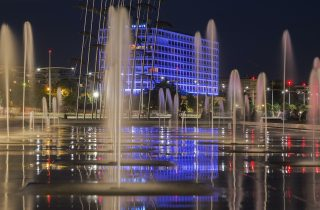 A view of the Makedonia Palace Hotel through the fountains.